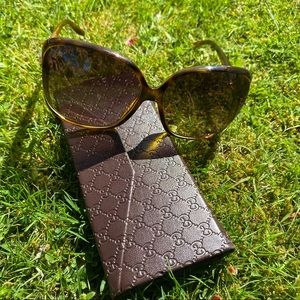 Gucci sunglasses with Gucci foldable leather case